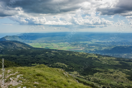 Foto op Aluminium Blauwe jeans soft focus summer colorful nature mountain landscape concept from above with view to ocean island field and horizon lane