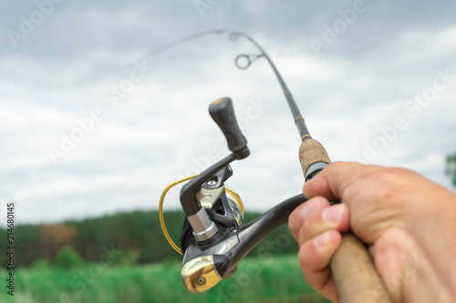 Fotografía  Spinning fishing is an exciting activity. Sport fishing.