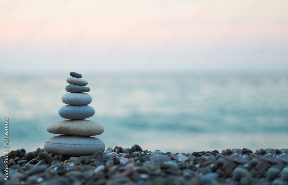 Fototapeta made of stone tower on the beach and blur background
