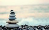 Fototapeta Fototapeta kamienie - made of stone tower on the beach and blur background
