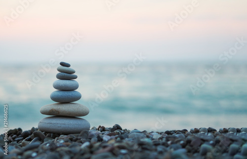 Photo made of stone tower on the beach and blur background