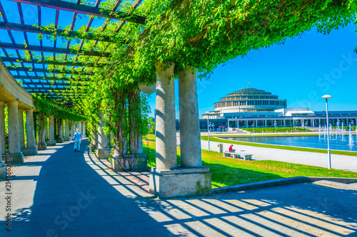 Fotografia An arcade covered with plants circulating fountain at Stulecia hall in Wroclaw,