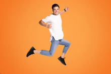 Happy Handsome Man Jumping Wit...