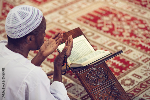 African Muslim Man Making Traditional Prayer To God While Wearing Dishdasha Wallpaper Mural