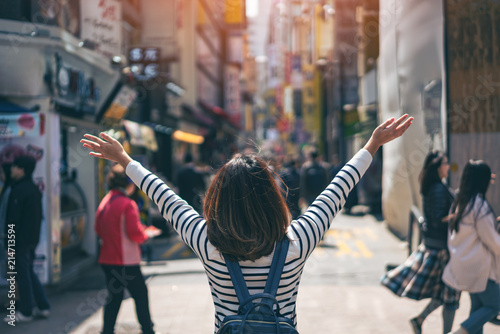 Keuken foto achterwand Seoel Young asian woman traveler traveling with happiness and shopping in Myeongdong street market at Seoul, South Korea. Myeong Dong district is the most popular shopping market at Seoul city.