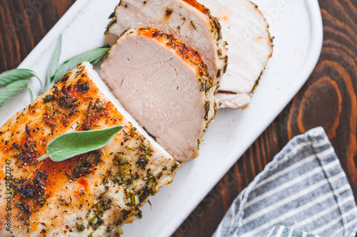Sliced pork loin roasted . Recipe with herbs. Canvas Print