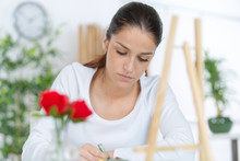 Woman Easel And Flower