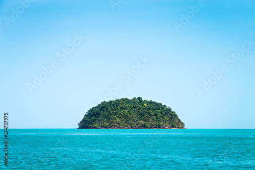 Tuinposter Eiland Round green island. Seascape with rock island in the tropical sea, Thailand. Blue clear sky.