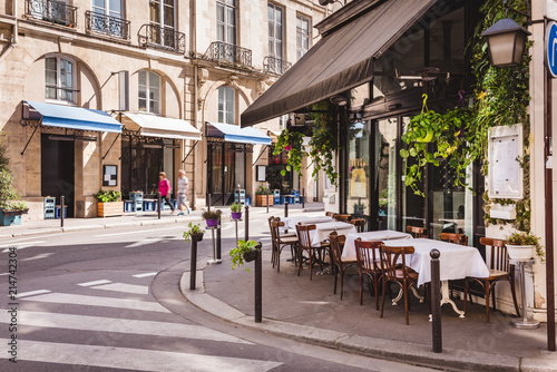 Fotografija Cozy street with tables of cafe  in Paris, France