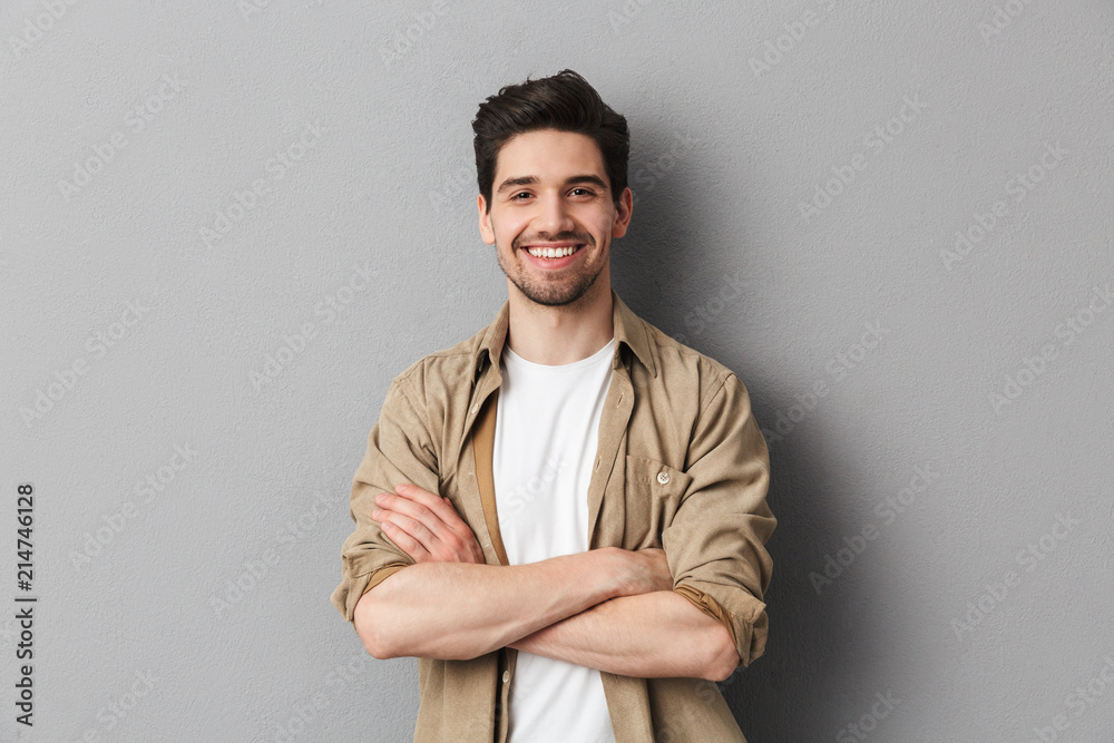 Fototapety, obrazy: Portrait of a happy young casual man standing