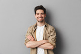 Portrait of a happy young casual man standing