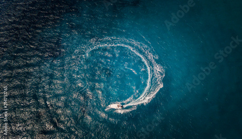 Aerial view of speed boat in circle motion
