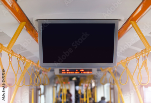 Foto auf Leinwand Stockholm advertising tv monitor inside tram