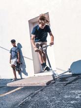 Teen Boys Skateboarding And Sc...
