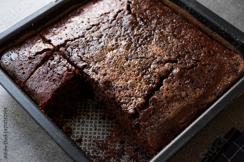 Square Juicy Chocolate Sponge Wet Cake with Sauce in Mold. Fototapet