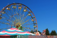 Ferris Wheel With Blue Sky Bac...
