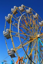 Colorful Ferris Wheel With Bright Blue Sky Background
