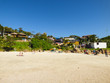 Florianopolis, Brazil - Circa July 2018: People enjoying a sunny day at Prainha da Barra, small beach near Barra da Lagoa
