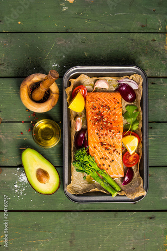 Baking dish with fresh raw salmon steak, vegetables  and seasoni Wallpaper Mural