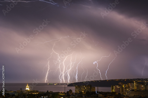 Keuken foto achterwand Onweer Storm over Varna, Bulgaria, with lightnings and flashes.