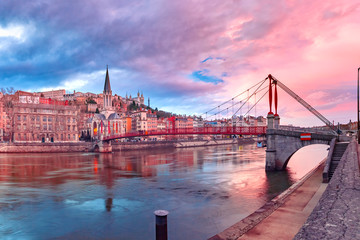 Saint Georges church and footbridge across Saone river, Old town with Fourviere cathedral at gorgeous sunset in Lyon, France