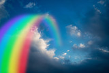 Fototapeta Tęcza - Colorful rainbow in clouds - beauty in nature concept.