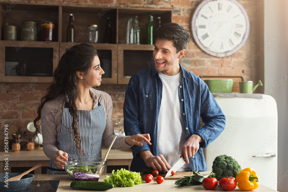 Fototapety, obrazy: Happy couple cooking healthy dinner together