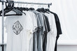 canvas print picture - selective focus of t-shirts with print on hangers in clothing design studio