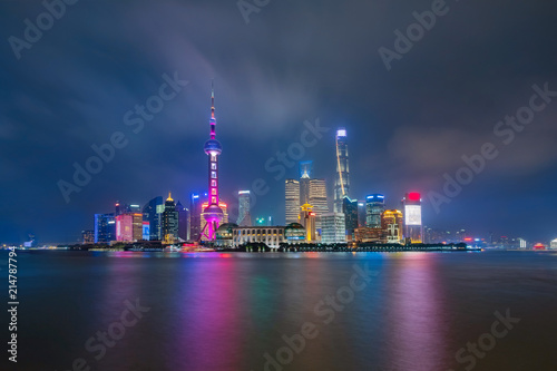 Shanghai city skyline Pudong side looking through Huangpu river on twilight time. Shanghai, China. Beautiful vibrant panoramic image.