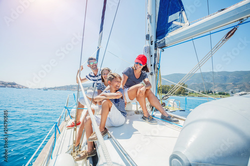 Family with adorable kids resting on yacht Fototapeta