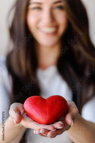 Fotografie, Obraz  Red Heart on Woman's Palms. Womans love, Valentines day.