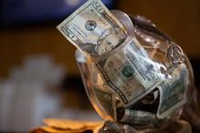 Tip Jar With 20 Dollar Bill