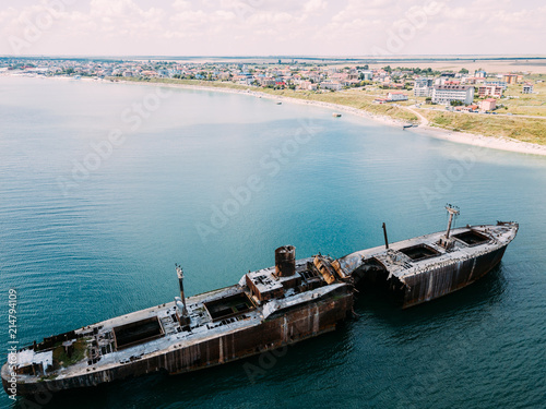 Spoed Foto op Canvas Schipbreuk Aerial Drone View Of Old Shipwreck Ghost Ship Vessel