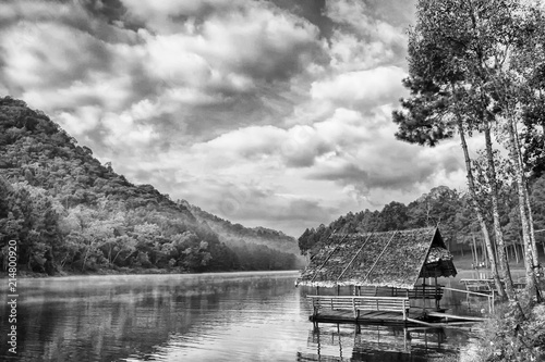 Fotobehang Grijs Floating house over the peaceful lake, beautiful lake, floating home, sight seeing, black and white