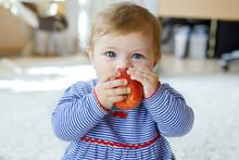 Little Adorable Baby Girl Eati...