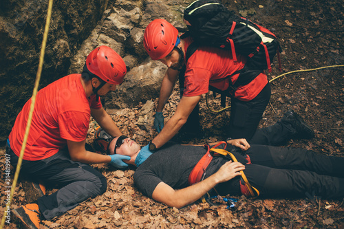 Search and rescue team helping injured alpinist Canvas Print