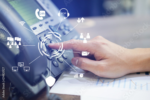 close up employee man hand press number on telephone for contact with virtual one stop business communication interface,technology concept