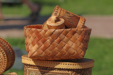 Carved Wooden Handmade Dishes In A Wicker Basket