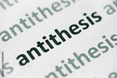 Photo word antithesis printed on paper macro