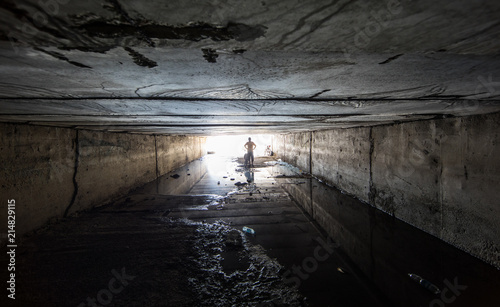 a man in an old dark tunnel