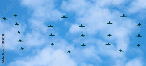 Fototapeta The largest ever formation of Royal Air Force Typhoons have spelt out 100 in the skies above Buckingham Palace to mark the centenary of the service