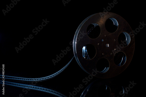 Photo  Movie reel on a black background