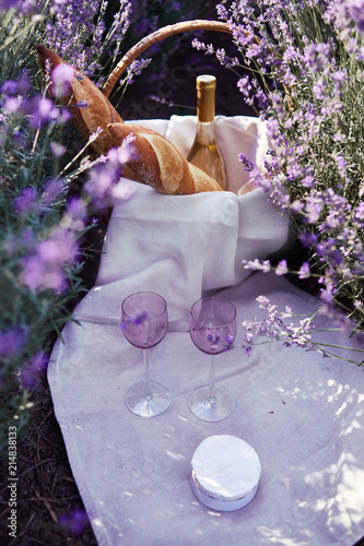 picnic in the lavender fields with french baguette and white wine