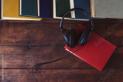 Books, Black Headphones on a Dark Wooden Background. Flat lay, t Canvas-taulu