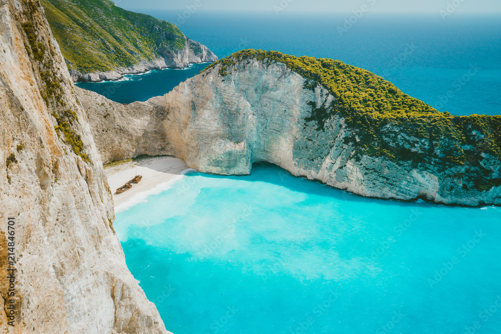 Fototapety, obrazy: Famous shipwreck on Navagio beach with turquoise blue sea water surrounded by huge white cliffs. Famous landmark location on Zakynthos island, Greece