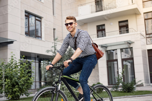 Deurstickers Ontspanning Staying healthy. Cheerful happy man riding a bicycle while leading a healthy lifestyle