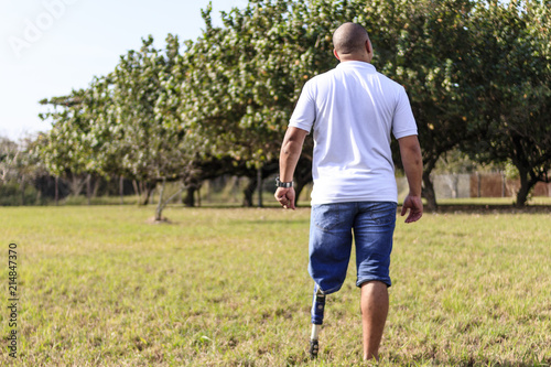 Man amputated with prosthesis contemplating outdoor landscape Canvas Print