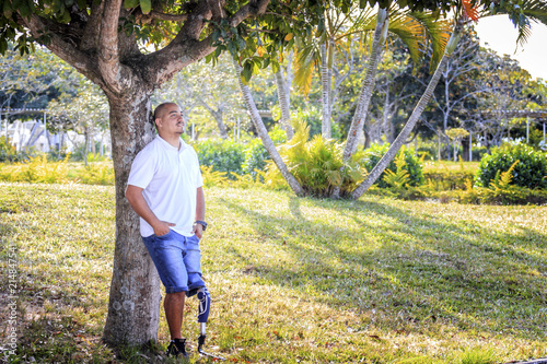 Man amputated with prosthesis relaxing outdoors Canvas Print