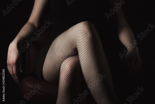 0337203b629 sexy women s legs in black fishnet stockings texture. woman knee in fishnet  stockings
