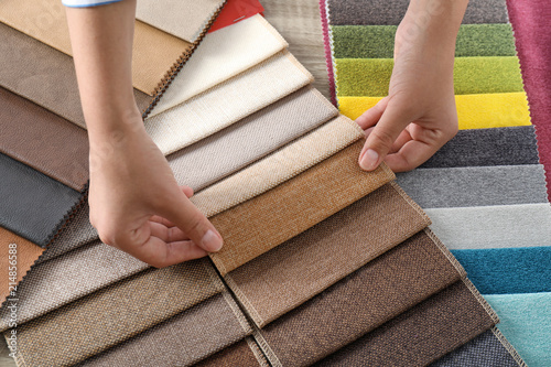 Aluminium Prints Fabric Young woman choosing among upholstery fabric samples, closeup. Interior design
